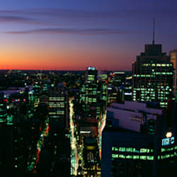 Buildings lit up at dusk, Sydney, New South Wales, Australia