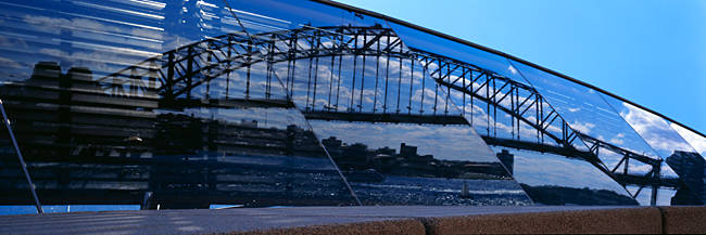 Reflection of a bridge on an opera house, Sydney Harbor Bridge, Sydney Opera House, Sydney, New South Wales, Australia