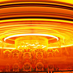 Merry-go-round lit up at night, Cardiff, South Wales, Wales