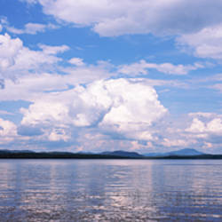 Reflection of clouds and trees in a lake, Raquette Lake, Adirondack Mountains, New York State, USA