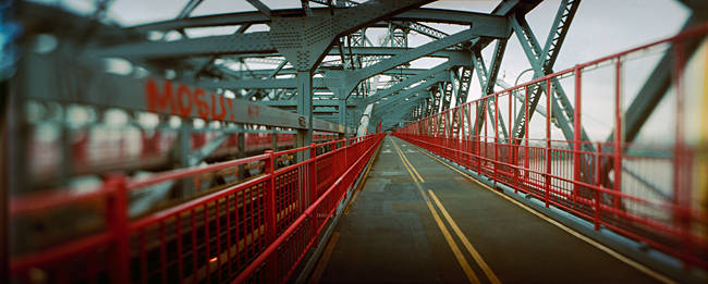 Road across a suspension bridge, Williamsburg Bridge, New York City, New York State, USA