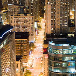 Buildings in a city lit up at dusk, Dearborn Street, North Side, Chicago, Illinois, USA
