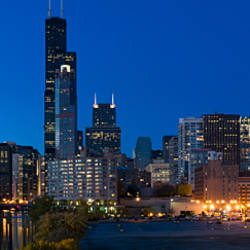 Buildings in a city lit up at dusk, Chicago, Illinois, USA