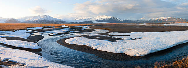 River passing through a snow covered landscape, Eskey, Iceland
