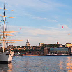 Schooner at a harbor with a city in the background with Hot Air Balloons in the sky, Af Chapman, Skeppsholmen, Stockholm, Sweden