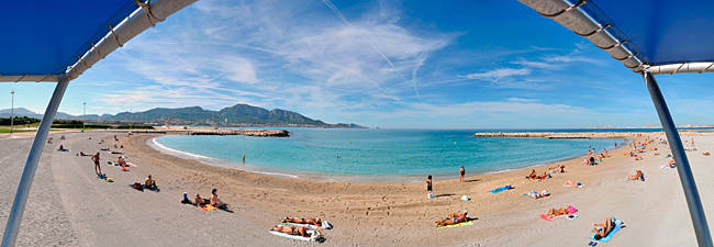 Tourists sunbathing on the beach, Prado Beach, Marseille, Bouches-du-Rhone, France