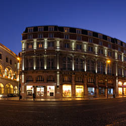 Buildings lit up at a town square, Rossio Square, Lisbon, Portugal