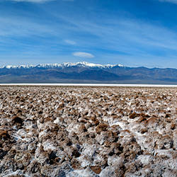 Salt flats with mountains in the background, Badwater Basin, Death Valley, Inyo County, California, USA