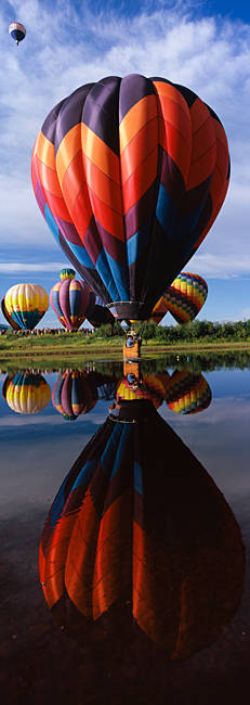Reflection of hot air balloons in a lake, Hot Air Balloon Rodeo, Steamboat Springs, Routt County, Colorado, USA