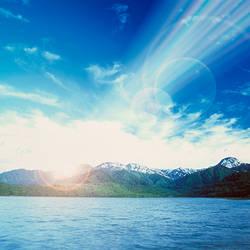 Sunbeams falling over mountain range