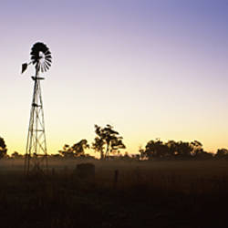 Silhouette of a windmill in a field, Cowaramup, Shire of Augusta-Margaret River, Western Australia, Australia