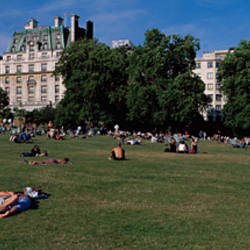 Group of people relaxing in a park, Green Park, London, England