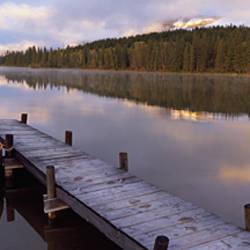 Boat moored at a pier, Hector Lake, Mt John Laurie, Rocky Mountains, Kananaskis Country, Calgary, Alberta, Canada