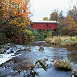 Covered bridge across a river, Northfield Falls, Vermont, USA