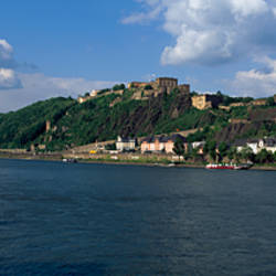 Passenger boat in a river with a castle in the background, Rhein River, Festung Ehrenbreitstein, Koblenz, Germany
