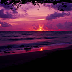 Sunrise over the sea, Pounders Beach, Oahu, Hawaii, USA