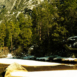 Rocks covered with snow at the riverside, Half Dome, Yosemite National Park, Mariposa County, California, USA