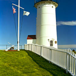 American flags near a lighthouse, Nobska Light, Woods Hole, Cape Cod, Barnstable County, Massachusetts, USA