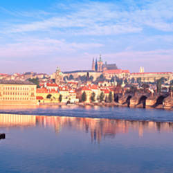 Arch bridge across a river, Charles Bridge, Hradcany Castle, St. Vitus Cathedral, Prague, Czech Republic