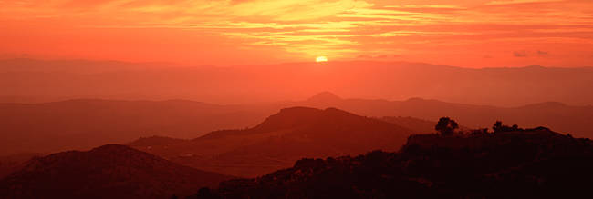 Silhouette of a mountain range at sunrise, Tuscany, Italy