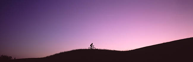 Silhouette of a person mountain biking, Waits River, Vermont, USA