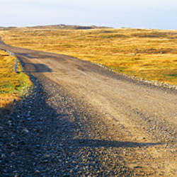 Gravel road passing through a landscape, Cape Bonavista, Newfoundland, Newfoundland and Labrador, Canada