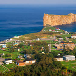 Town with rock formation in the river, Perce Rock, St. Lawrence River, Gulf of Saint Lawrence, Gaspe Peninsula, Quebec, Canada