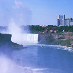 Waterfall with city skyline in the background, Niagara Falls, Ontario, Canada