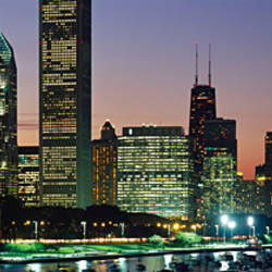 Buildings lit up at dusk, Lake Michigan, Chicago, Cook County, Illinois, USA