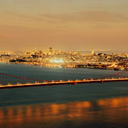 Suspension bridge lit up at dusk, Golden Gate Bridge, San Francisco Bay, San Francisco, California, USA