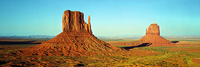 Rock formations on a landscape, The Mittens, Monument Valley Tribal Park, Arizona, USA