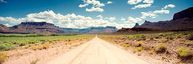Dirt road passing through a landscape, Onion Creek, Moab, Utah, USA
