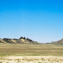 Rock formations on an arid landscape, Ship Rock, San Juan County, New Mexico, USA