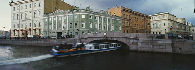Tourboat under a bridge, Moika River, St. Petersburg, Russia
