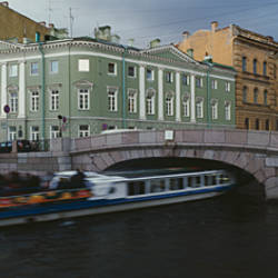 Tourboat under a bridge, Moika River, St. Petersburg, Russia