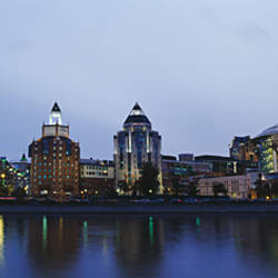 Buildings lit up at the waterfront, Swissotel Krasnye Holmy Hotel, Moskva River, Moscow, Russia