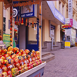 Senior man selling Russian nesting dolls in the street, Arbat Street, Moscow, Russia