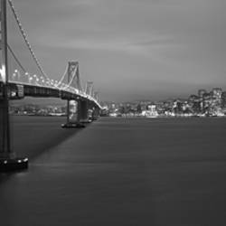 Low angle view of a suspension bridge lit up at night, Bay Bridge, San Francisco, California, USA