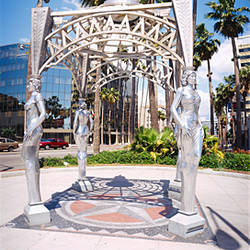 Low angle view of statues in front of a building, Hollywood Boulevard, City of Los Angeles, California, USA