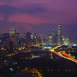 High angle view of buildings lit up at dusk, Chicago, Illinois, USA