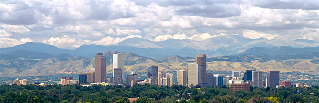 Clouds over skyline and mountains, Denver, Colorado, USA