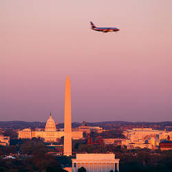 High angle view of the Lincoln Memorial, Washington Monument, and US Capitol Building at sunset, Washington DC, USA