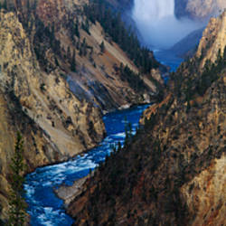 Waterfall falling into stream through a canyon, Yellowstone National Park, Wyoming, USA