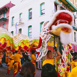 People performing traditional Dragon Dance on Chinese New Year, Chinatown, San Francisco, California, USA