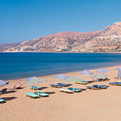 Beach umbrellas on the beach, Palaiochora, Crete, Greece