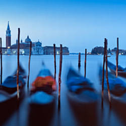 Row of gondolas moored near a jetty, Venice, Italy