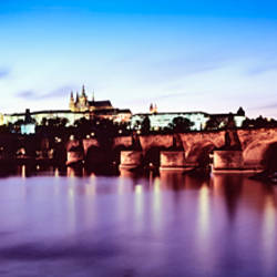 Arch bridge across a river with a cathedral in the background, St. Vitus Cathedral, Hradcany Castle, Vltava river, Prague, Czech Republic