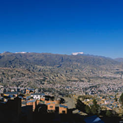 High angle view of a city with mountains in the background, Mt Illimani, La Paz, Bolivia