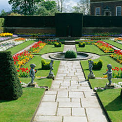 Formal garden in front of a palace, Hampton Court Palace, London, England