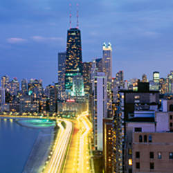 Skyscrapers lit up at the waterfront, Lake Shore Drive, Chicago, Cook County, Illinois, USA